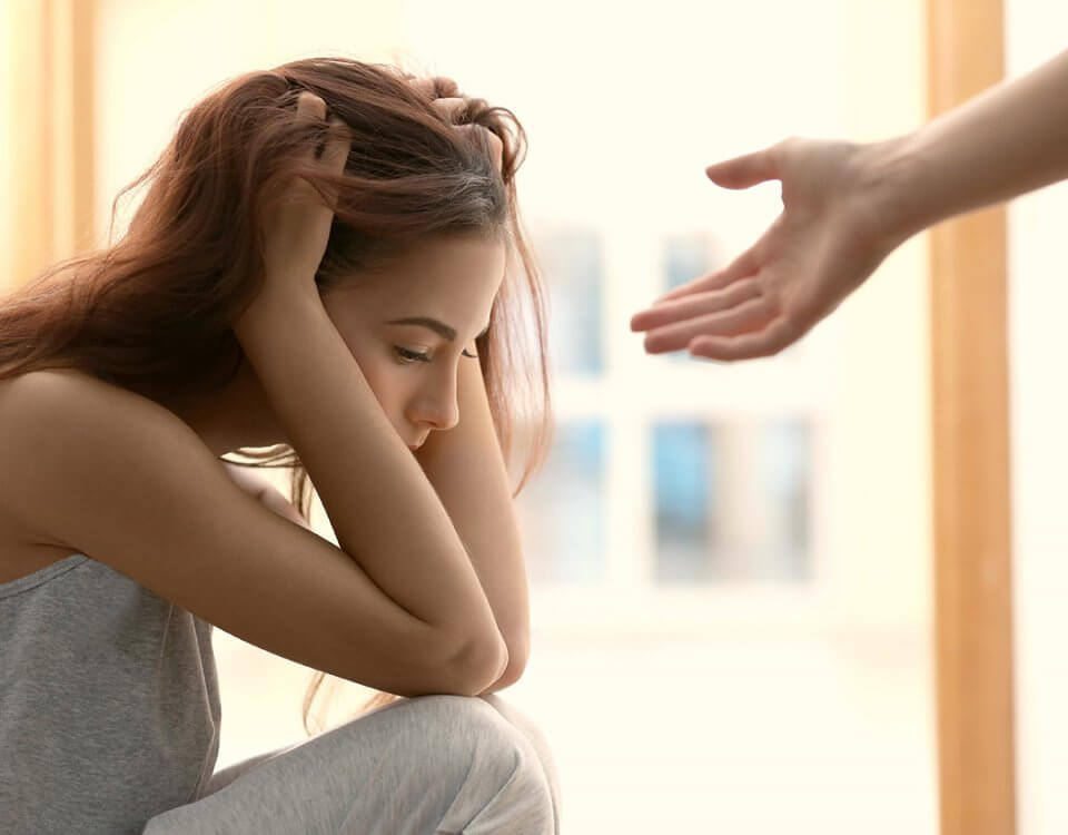 woman with hand reaching to help