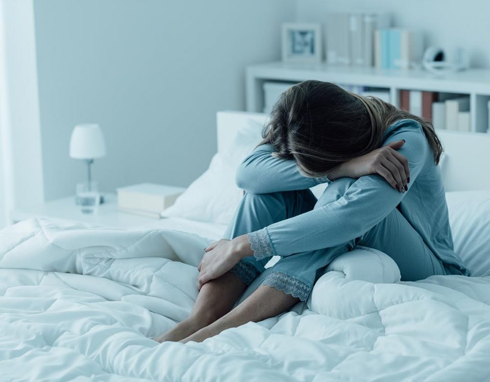woman with depression in bed